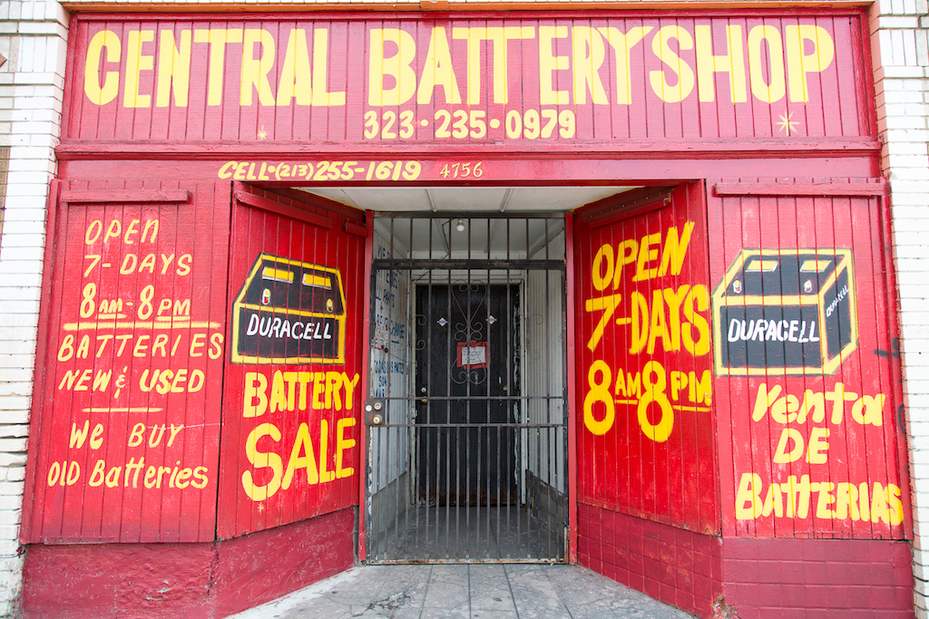 Central Battery Shop at 4756 S. Central Avenue, south of downtown Los Angeles, is entirely covered in red paint, yellow lettering and freehand portraits of batteries.