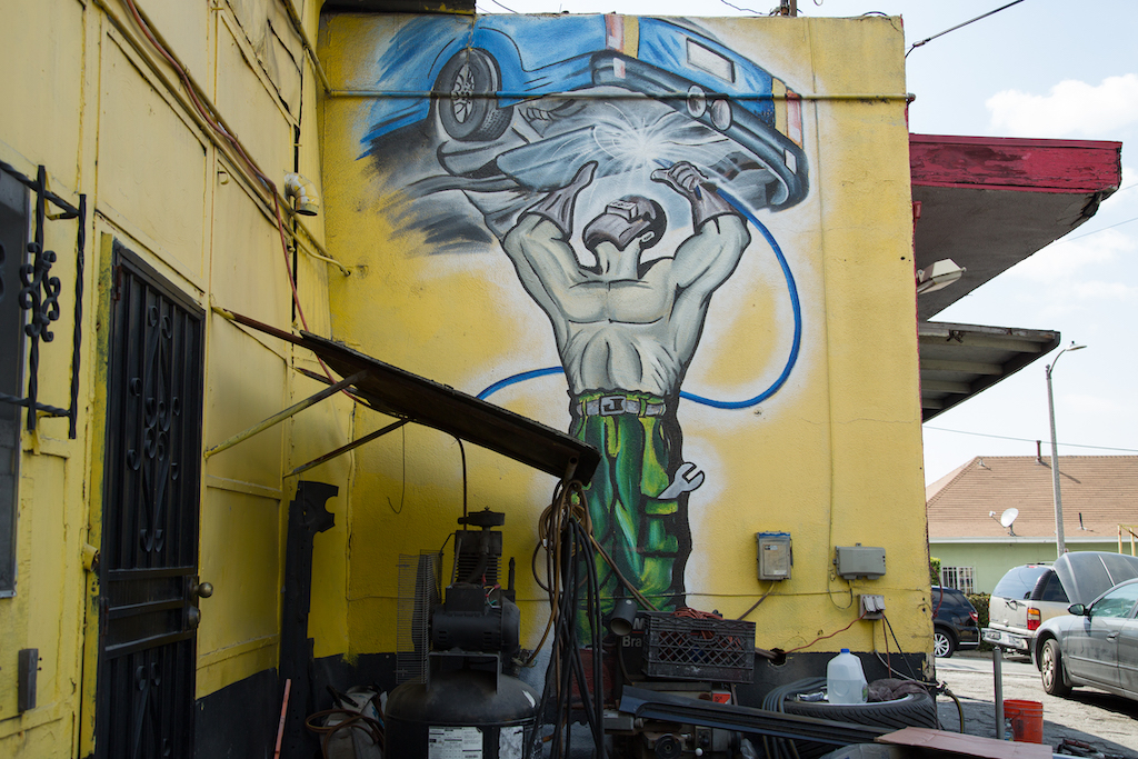 This illustration of a muffler installation was created a dozen years ago by an itinerant painter named Alex at Cesar Chavez Body Shop, 1400 Cesar E. Chavez Avenue in East Los Angeles.