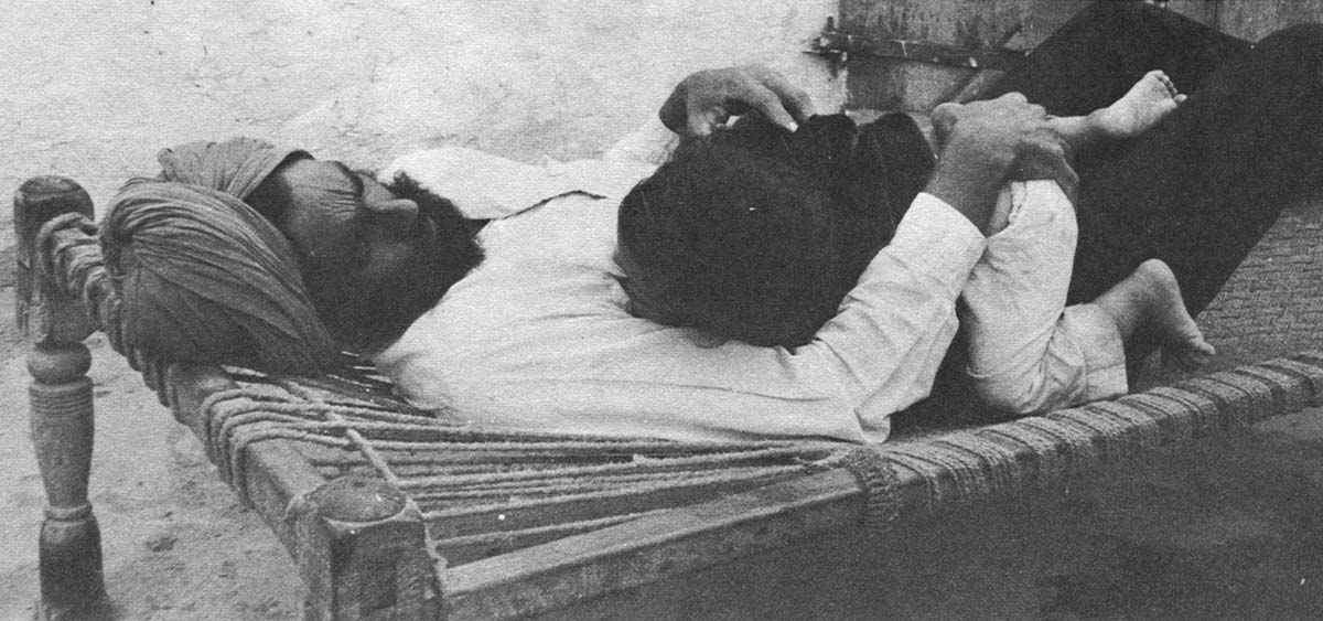 Charan laughed and picked up the little boy in his arms and together they laid down on a charpoy.
