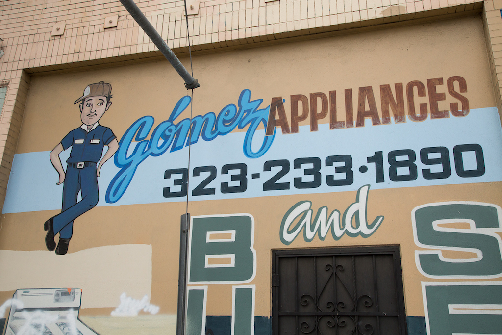 At 5401 S. Central Avenue, Gómez Appliances has a profusion of fonts, a dapper-looking repairman and illustrations of ranges and refrigerators.