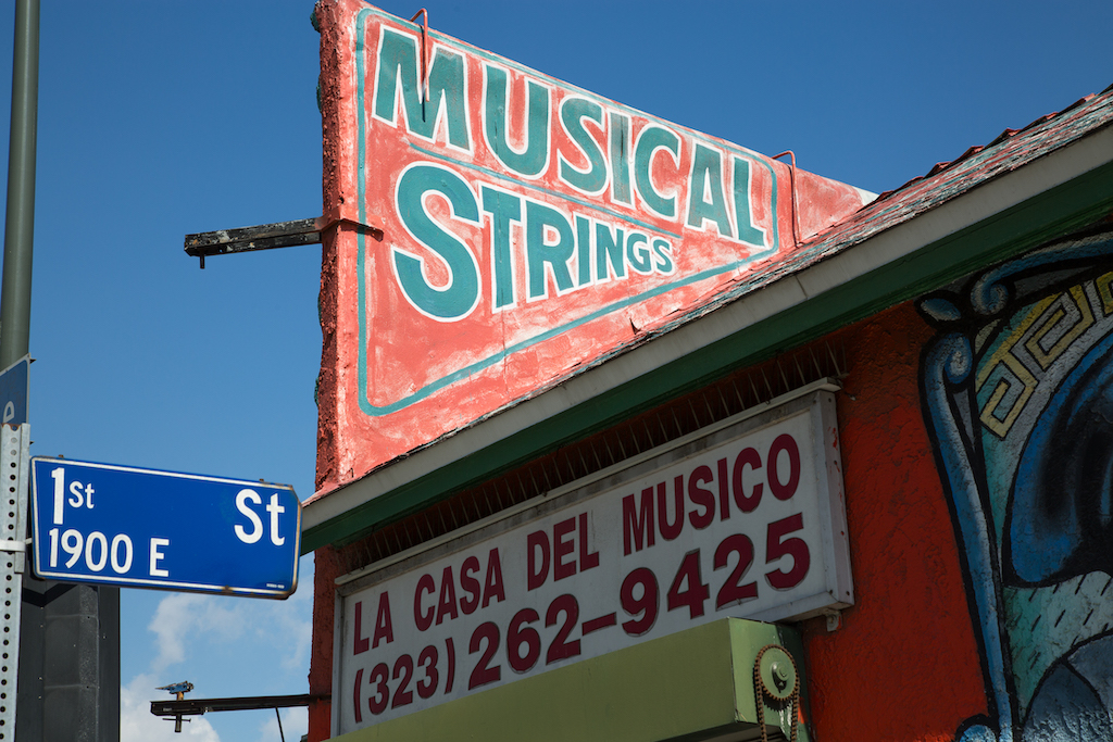 La Casa del Musico has been on the corner of First and State streets in East Los Angeles for 39 years. The sign letting passersby that it offers musical strings has been there about half that time.