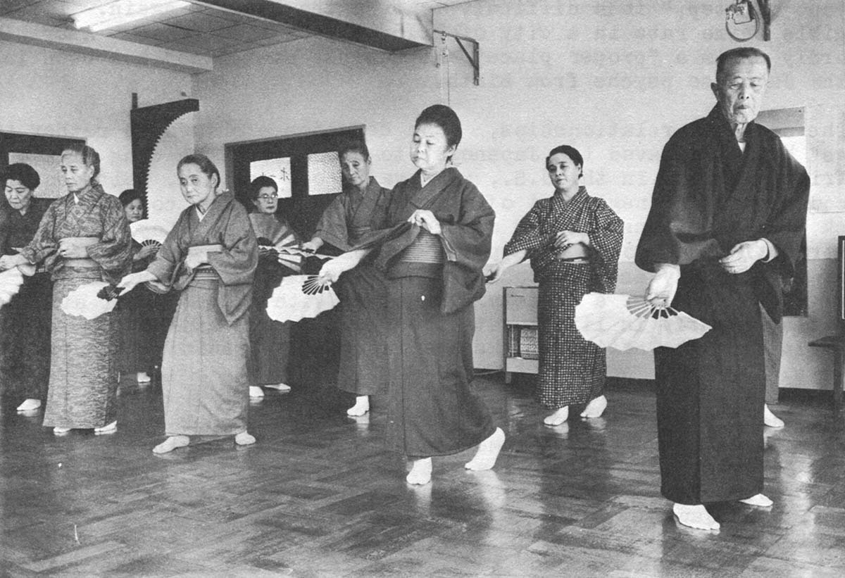 "Mrs. Terada, third from left, front, practices her ""democracy,"" a fan dance called Shigesa-Bushi, at the Chichibu Ondo social club for the elderly in Tokyo."